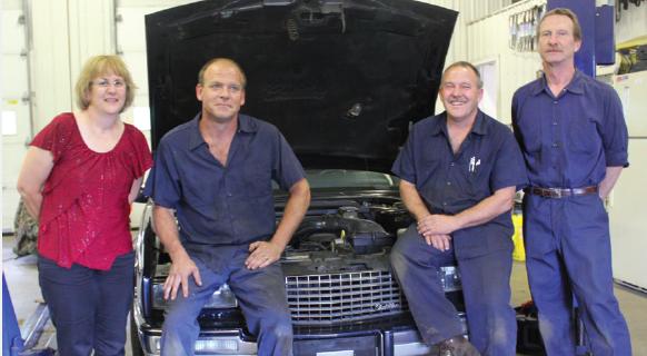 Margaret Landrum, Tim Landrum, Dan Leering and Randy Smith in the Lovell Auto shop