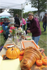 Sue Bertch inspects a 2012 Harvest Festeval vendors display.