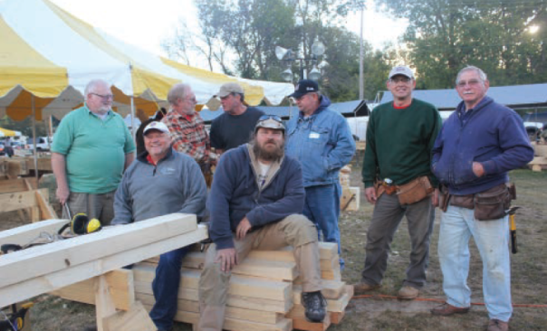 Local volunteers working with the timber frames include, from left to right, Jim Bird, John Polasek, Hisko Timmermans, Richard Barnes, Chris Newman, Bob Smith, John, Woflgang Lugauer