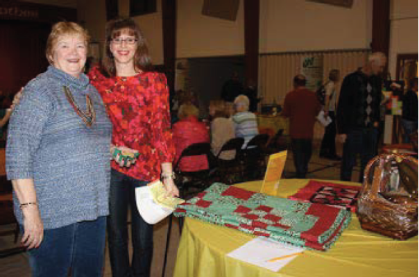 Carrie Gloystein and her mother, Beth Boswell, donated her handmade quilts during last year's Fall Extravaganza