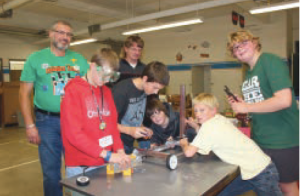Students put pieces together to build the framework for the robot they hope to enter into the design contest for robotics. The robots will be on display during Science night early next year at the Vicksburg Middle School.