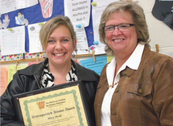 Mary Burke was honored by the Vicksburg School Board for being selected to receive the 2013 Distinguished Alumni Award from Western Michigan University. She is pictured here with Laura Kuhlman, the Vicksburg Middle School principal.