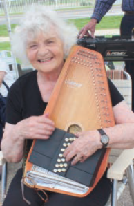 June Kucks plays the dulcimer as a member of the First Sunday Jammers. Her husband Wayneis also a member of this group who volunteer their musical talent at the Vicksburg Farmers Market during the summer.