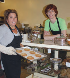 Heidi Powell the bake goods expert & Scott Krieger the manager, display cookies just out of the oven.