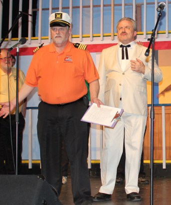 Dale Muyskens, is captain of the S.S. Rotary Ann, with Ken Franklin in the background.