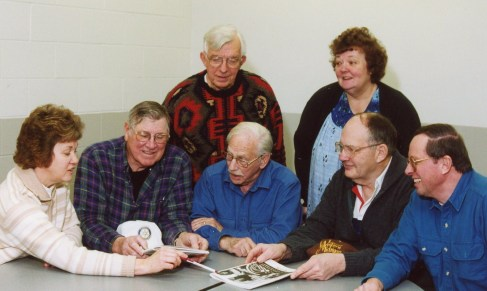 The advertising committee for the Showboat program, worked behind the scenes in relative obscurity, but actually brought in the most money each year. Pictured here from left to right, Gen Landtroop, Richard Coppes, Arle Schneider, Warren Lawrence, Jim Shaw. Standing in back, Charlie Kendall and Jackie Lawrence.