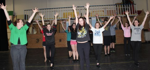 Dancers for Shrek, the Musical, is in rehearsal, led by director Melissa Sparks on the far left.
