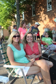 Melissa Jamerson on the right, the mother of Dani Jamerson whose band played during the Taste, enjoys the music with a friend.