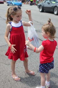 Children love to pick up candy thrown from the many floats in the 4th of July parade.