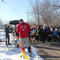 Frostbite runners leave the start gate in 2014 at the Recreation Trail.