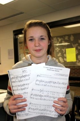 Mackenzie McCowen displays her music that she will sing as she advances from the state solo & ensemble festival for choir.