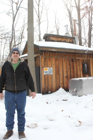Terry Moyer stands in front of his Sugar Shack where he cooks down the maple syrup in an evaporator. He also sells his maple syrup from his home that is hidden back in the woods off of Flach Road in St. Joe County.