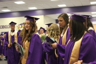 Schoolcraft students gather in the cafeteria after the recessional to pick up their actual diplomas.