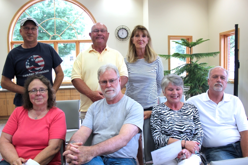 Current crew of the Schoolcraft 4th of July planning committee appeared before the village council requesting replacement for several retiring members. They are seated left to right: Deb Reynolds, parade chair who is retiring; Chip and Virginia Mongrieg, long-time volunteers with Chip in charge of the annual fireworks shop until this year; Jon Krum, finances. Standing left to right in the back: Randy Palmer, this year's fireworks chair; Jim and Monica Rasmussen, parade assistants to Reynolds who will be retiring; Kathy Stiver was absent when the meeting took place.