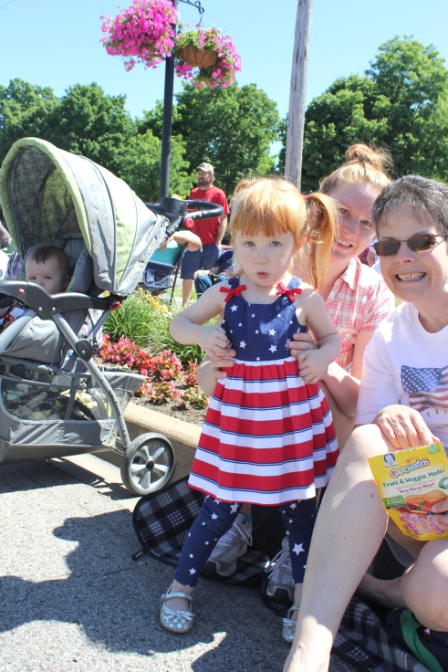 Parade goers line the streets in Schoolcraft at an early hour to get the best seats. Many, like this little girl, are dressed in their finest 4th of July attire.