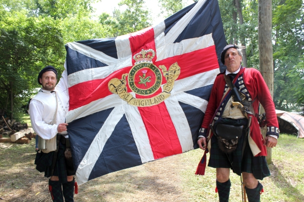 Stefan Sekula and his co-commander Timothy Gora display the flag of the 84th Scottish Highlanders, the unit for which they are re-enactors. This unit served at Fort Michilimackinac.