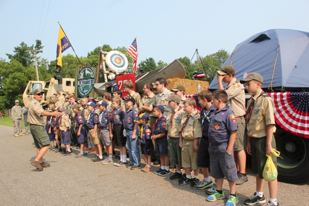 Kevin Borden lines up Boy and Cub Scouts in Troop 251 as they get ready to march in the July 4 parade in Schoolcraft.