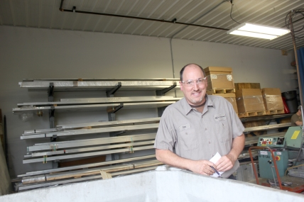 Operations Manager Dan Harrison oversees production in the Craft Precision building on Lyons Street in Schoolcraft.