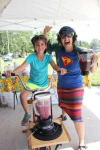 The Fresh Food Fairy brings her bike that powers a blender that makes smoothies. She was part of Kids' Plate at the Vicksburg Farmers' Market in July.