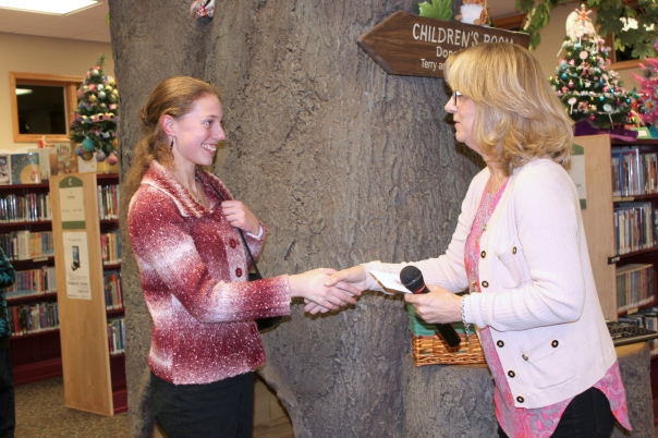 Debra Christiansen, right, congratulates one of the 2014 Tournament of Writers winners.