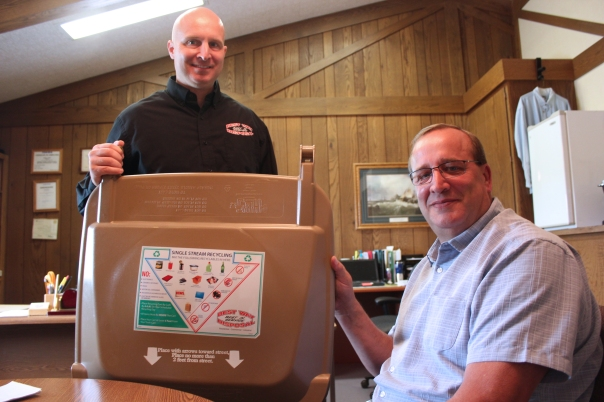 Chris Phillips and Steve Graffenius show the legend on top of all of Best Way's curbside bins that helps their customers determine what will be acceptable for recycling.