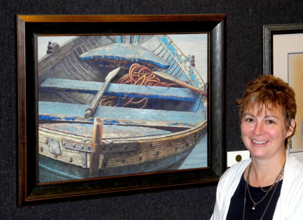 "Helen Kleczynski proudly displays her pastel painting, ""Old Blue."""
