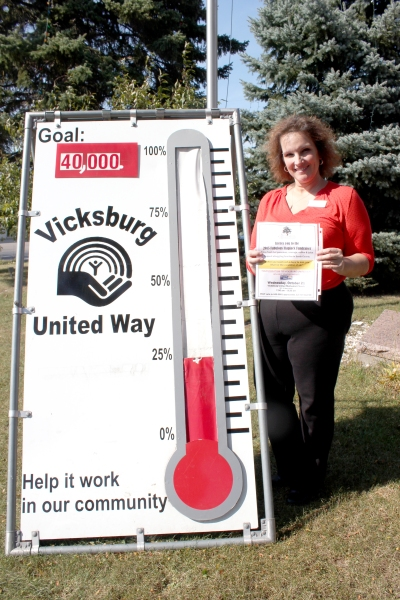 Ann Marie Earl displays the invitation to the 2015 Fabulous Flapjack Fundraiser, which will push the United Way thermometer to a much higher level.