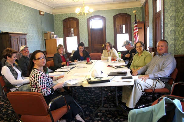 Members of the Vicksburg DDA board listen to a presentation by Emily Pantera of the Michigan State Housing Development Authority on its bid to become a Main Street 'select' designation. Seated from front, left to right: Pantera, Mandy Miller, Mike Oswalt, Mary Marshall, Kathleen Hoyle, Julie Merrill, John DeBault, Stella Shearer, and Steve McCowen.