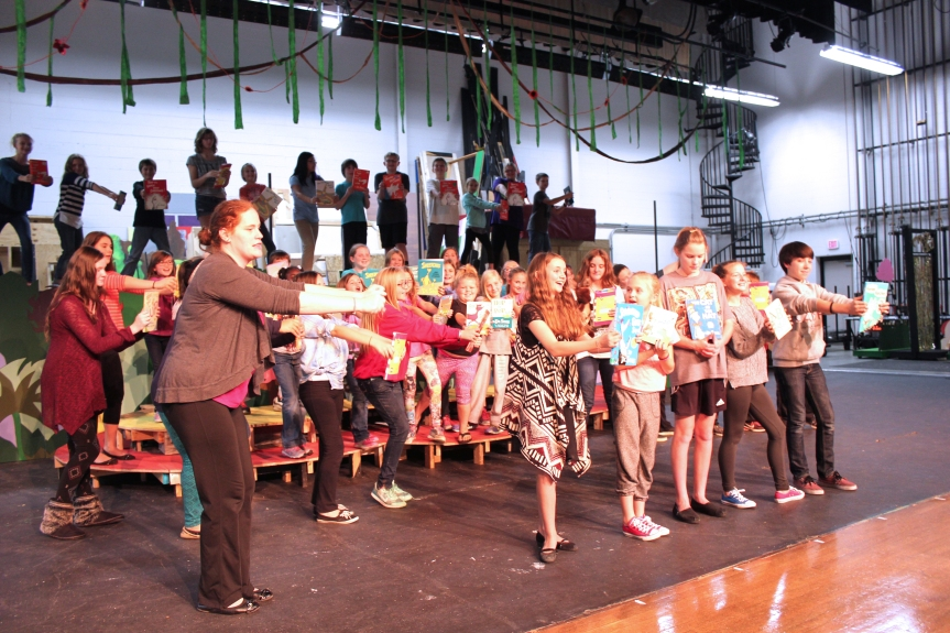 Melissa Sparks, on the left, directs elementary and middle school students in Seussical, Jr. a musical centered around Dr. Seuss's books for children.