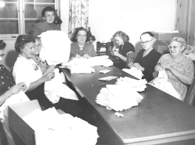 The ladies from the Hospital Guild in the 1950s would sew blankets and baby clothes for the newborns at Franklin Memorial Hospital on S. Main Street.