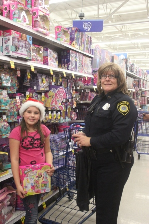 Mary Secondi, Schoolcraft police, joined other officers from South County to take children shopping for Christmas gifts for the families.
