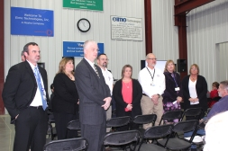 Eimo management employees are introduced to those attending the open house.