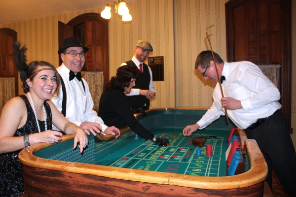 Kent Williams, a trained croupier, tends the tables for gambling chips that turned into prizes later in the evening.