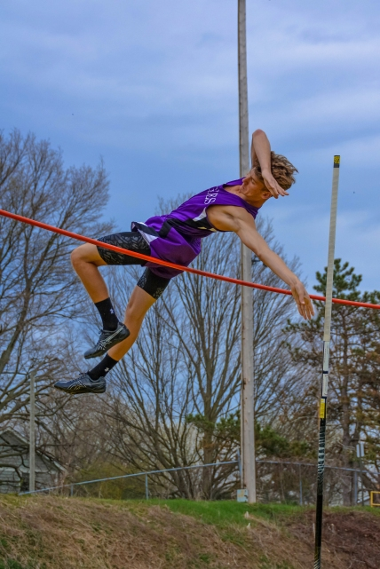 Walker Small goes high in the pole vault.