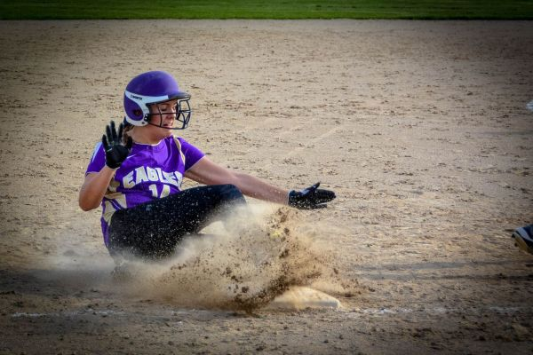 Abby Pincumbe slides into third base. All photos by Stephanie Blentlinger, Lingering Memories Photography.