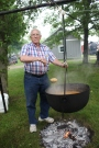 Tom Welch stirs up his pot of beans.