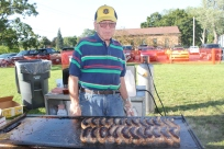 "Bob Merrill is an expert at cooking brats along with the other three guys from the Lions Club who help to cook the brats each summer. ""I think I cook them better than the other guys because I use a lot less grease and get them just right without deep frying them,"" Merrill claims. He ought to know, since he is almost a founding member of the Lions Club and has been cooking the brats in tandem with John Polasek and Wayne Smith for years."