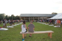 Spectators cheer on the cornhole contest that attracted 92 bean bag pitchers in 2015.