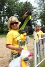 Deborah Harsha holds up the Duck Derby trophy to be awarded to the winning elementary classroom during the Old Car Festival on June 11 in Vicksburg.