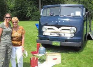 Michelle Zerilli and Jan Hawke pose in front of Terry Hawke's 1959 P Series Truck.