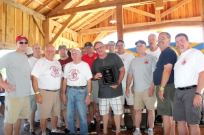The Lions Club stopped all the activity at their recent Summer Festival to present Ken Schippers with a plaque. It was a special thank you for all of the help he has given their organization over the years.