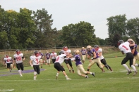 Payton Hoskins, #12, with the ball.