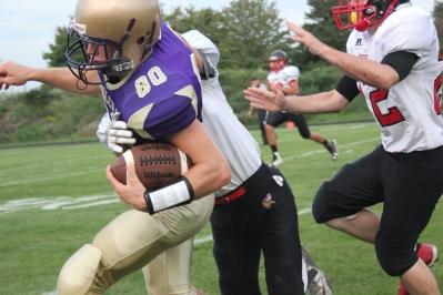 Ben Crofott, #80, as he is being tackled.