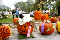 The pumpkin carving contest is a hit with the younger crowd but parents are often a big help with knives and design work.
