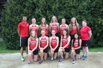 Girls Cross Country Front row left to right: Kasmyn VanMaanen, Alex Moss, Angel Currie, Angie Loriso, Therese Thamann. Back row left to right: Coach Lucas Wolthuis, Kassie Lash, Abbey Lafler, Hannah Flickinger, Sunny Solbakken, Layna Steele, Assistant Coach Anne Jasiak.