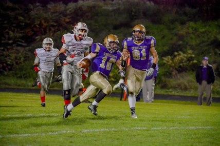 Skip Fox running the ball. Photo by Stephanie Blentlinger, Lingering Memories Photography.