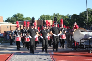 The Vicksburg band enters the stadium before the first home football game, led by Paxton Earl, Abbey Oswalt and Adam Decker.