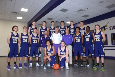 Boys Varsity Basketball Kneeling, from left:  Kobe Clark, Hunter Johnson. Middle row, left to right: Max Kulczyk, Riley Piper, Reilly Puhalski, Coach Adam Sziede, Coach Randy Small, Team Assistant Caleb Anspaugh, Ricky Clark, Jakob Huysken, Caleb Eustice. Back row, left to right: Rielly Troyer, Chris Butler, Matt Schuppel, Blake Bales, Jason Feddema, Nolan Anspaugh.