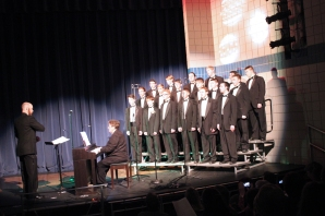 Dusty Morris directs the Simply Men chorus as part of the Vicksburg High School Fine Arts Department Christmas Concert. Karla Stubblefield accompanied them.