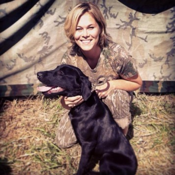 Kristin Youngs holds Margo, one of the dogs they have raised.